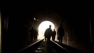 540458614-light-at-the-end-of-the-tunnel-work-clothing-safety-suit-train-tunnel